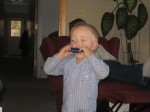 Sam and his new harmonica that his evil uncle got all the boys